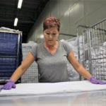 Processed linen being examined by Dana Mariana Bolboaca at Regenex